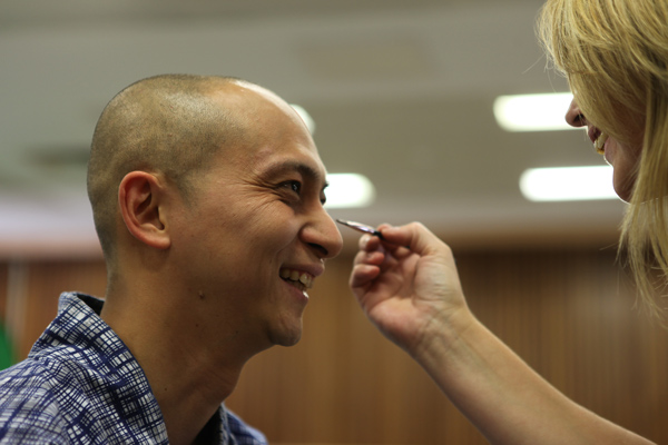 Leo having a spot of make-up retouching!