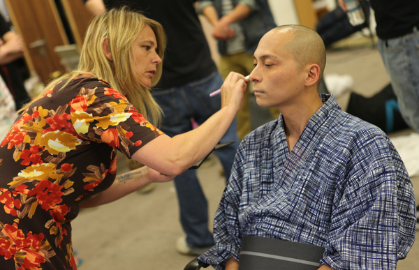 Birmingham South and City student Tania Ashworth applying make-up to Leo Ashizawa